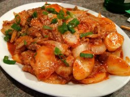 Tteokbokki (soft rice cakes with vegetables in spicy sauce)