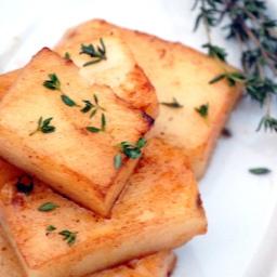 Fondant potatoes with honeyed carrots and creamy butter-wine sauce